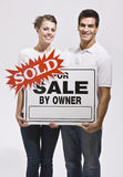 Couple Holding For Sale By Owners Sign Stock Photography