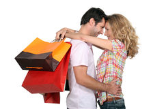 Couple holding shopping bags Stock Photos