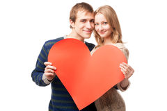 Couple holding sign in form of red heart Royalty Free Stock Image