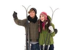 Couple holding skis