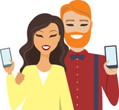 Couple holding smartphones Royalty Free Stock Image