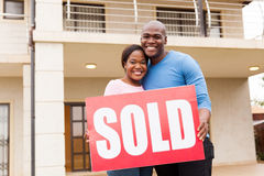 Couple holding sold sign Stock Images