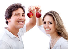 Couple holding some apples Stock Photos