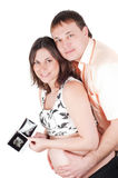 Couple holding a sonogram of their child Royalty Free Stock Photo