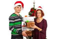 Couple holding stak of Xmas gifts Royalty Free Stock Photography