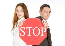 Couple holding stop sign Stock Photo