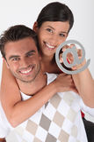Couple holding at symbol Stock Photos