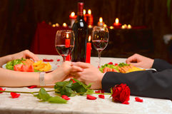 A couple holding their hands. At a romantic dinner Royalty Free Stock Photo