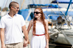 Couple holding their hands each other,harbour view Royalty Free Stock Photo