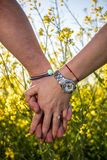 Couple holding their hands. Engagement ring. Engagement photo with a couple which is holding their hands. Colorful background Stock Photo
