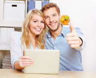 Couple holding thumbs up Stock Image