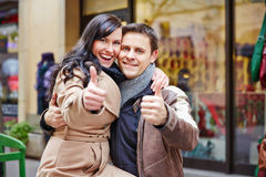 Couple holding thumbs up while Royalty Free Stock Image