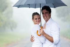 couple holding umbrella stock image