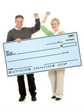 Couple: Holding Up a Blank Check Royalty Free Stock Photo