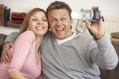 Couple Holding A Video Camera Royalty Free Stock Photos
