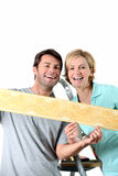 Couple holding wallpaper border Stock Photography