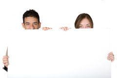 Couple holding white banner Royalty Free Stock Image