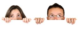 Couple holding a white banner add Royalty Free Stock Photos