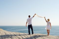 Couple holding a white handkerchief Stock Photography