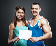 Couple holding white poster together Stock Photography