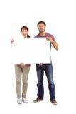 Couple holding a white sign Stock Photos