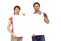 Couple holding a white sign Stock Images