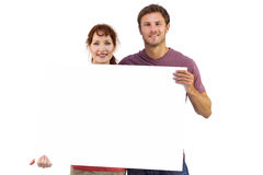 Couple holding a white sign Royalty Free Stock Photography