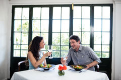 Couple holding wine glass and interacting Stock Images