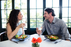 Couple holding wine glass and interacting Royalty Free Stock Image