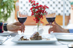 Couple holding wine glasses in the restaurant. Royalty Free Stock Images