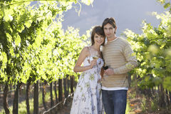 Couple Holding Wine Glasses In Vineyard Royalty Free Stock Photo
