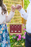 Couple holding wooden frame in hands Royalty Free Stock Images