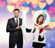 Couple holding word LOVE Stock Photo