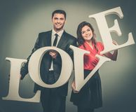 Couple holding word LOVE Stock Image
