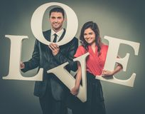 Couple holding word LOVE royalty free stock images