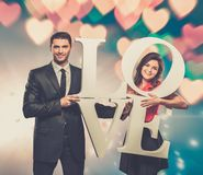 Couple holding word LOVE Royalty Free Stock Image
