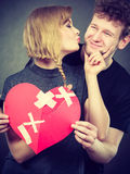 Couple holds broken heart joined in one Royalty Free Stock Image
