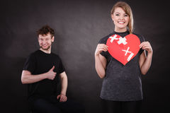 Couple holds broken heart joined in one Stock Images
