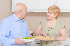 Couple holds a plate with salad Royalty Free Stock Images