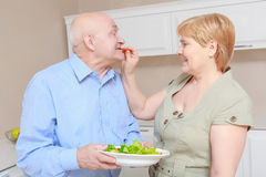 Couple holds a plate with salad Stock Photos