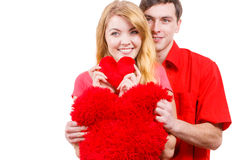 Couple holds red heart shaped pillows love symbol. Couple. Boyfriend and his girlfriend holding red heart shaped pillows love symbol. Romantic women and men stock photography