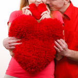 Couple holds red heart shaped pillows love symbol. Couple. Boyfriend and his girlfriend holding red heart shaped pillows love symbol. Romantic women and men stock photos