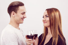 Couple and holiday concept - smiling young woman with glass of wine Royalty Free Stock Images