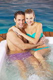 Couple in holiday relaxing in whirlpool Stock Image