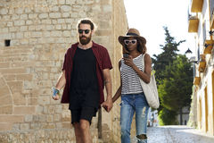 Couple on holiday walk, looking at phone, Ibiza, Spain Stock Images