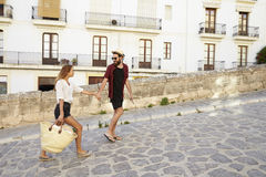 Couple on holiday walking in the street holding hands, Ibiza Royalty Free Stock Photo