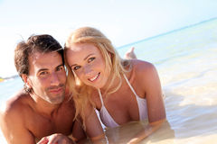 Couple on holidays at the beach. Just married couple bathing in crystal clear water Stock Photography