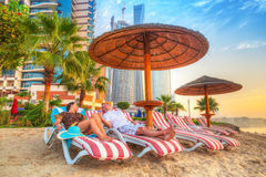 Couple on holidays at the Persian Gulf. Of Abu Dhabi Royalty Free Stock Photos