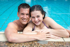 Couple in holidays posing at hotel pool edge Royalty Free Stock Photography