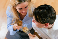 Couple at home with champagne Stock Photography